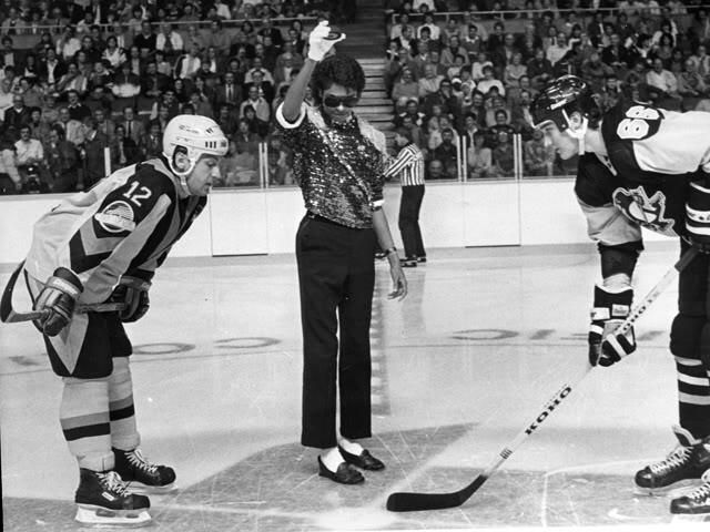 Michael Jackson drops the puck for a game between the Vancouver Canucks and the Pittsburgh Penguins. Vancouver, 1984