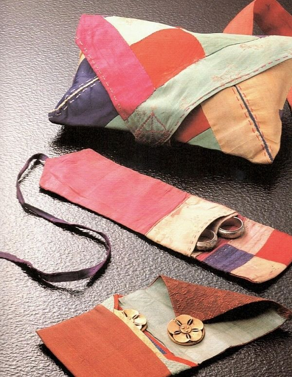 A lovely little sewing set and pouch, including scissors case and lined buttons pouch. 19th century and looks like silk. From a collection of 50 pojagi at the Korea Fashion Association website.