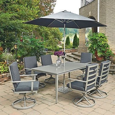 South Beach 9 Pc. Rectangular Outdoor Dining Table; 6 Swivel Rocking Chairs with