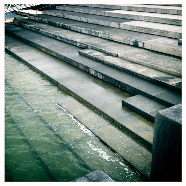 """5km Tuesday lunchtime run. This is my favourite sculpture that I encounter on my way through Wynyard Quarter. It's called """"Silt Line"""" and is a set of cast concrete tidal steps by Rachel Shearer & Hillery Taylor Architecture. I love looking at the steps disappear into the water and also the different shapes and heights of the steps themselves."""