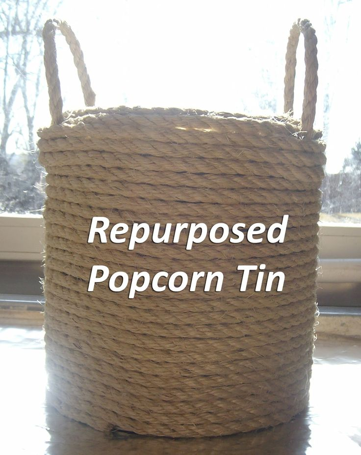 DIY: Repurposed Popcorn Tins- popcorn tin, hot glue, and twine or rope to make a decorative trash can for 1/2 bath...but without handles