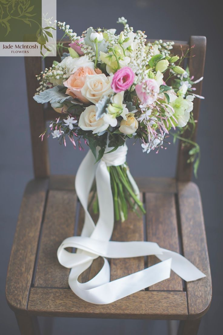 Pink lisianthus, peach and cream roses, pieris and sweet pea in posy finished with trailing star jasmine and long cream ribbon. www.jademcintoshflowers.com.au www.mjphotography.com.au