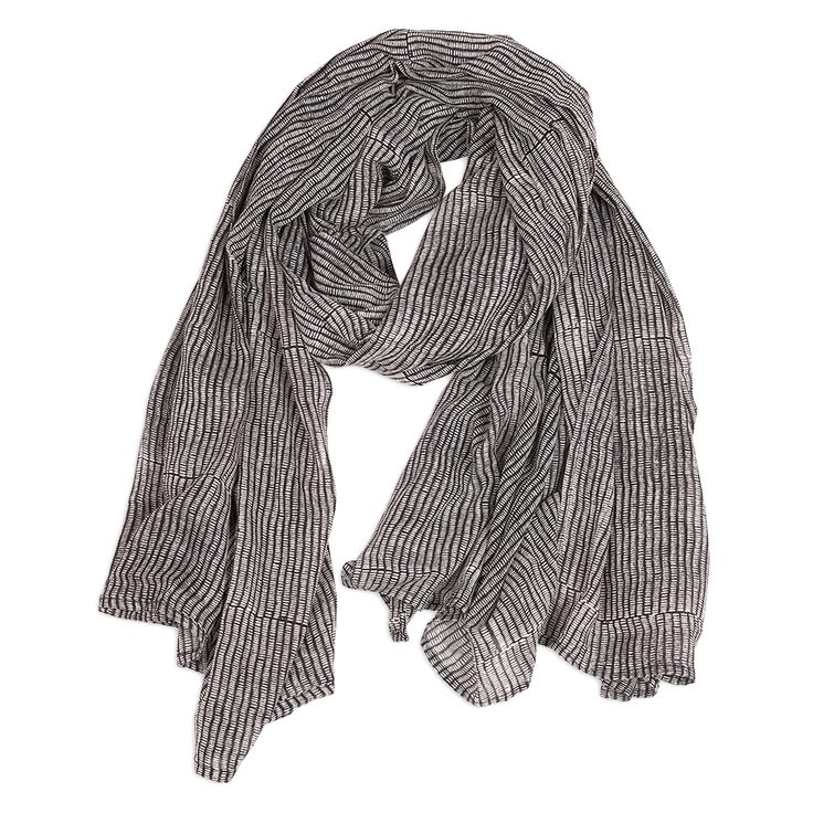 We love this easy, breezy scarf, packed with texture and detail in a rich midnight color. Full of repeating tiny, hand-drawn lines, our design is hand-block pri