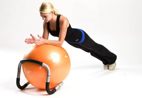 The Halo Trainer from physical therapist @Bryce Taylor  and @Merrithew Health & Fitness Health & Fitness is a handy apparatus that you use with a stability ball, with other equipment like a #BOSU ball or even on its own. You can put the Halo under the ball for better stability when sitting or doing planks. Or placing the Halo on top of a ball – sort of like handlebars – makes for better ergonomics when doing pushups and similar exercises. #core #fitness