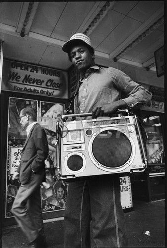 B Boy with his JVC RC - 5500 Boombox, 42nd street New York, USA, 1980    This image is used in the book The Boombox Project by Lyle Owerko.    by Peter Anderson