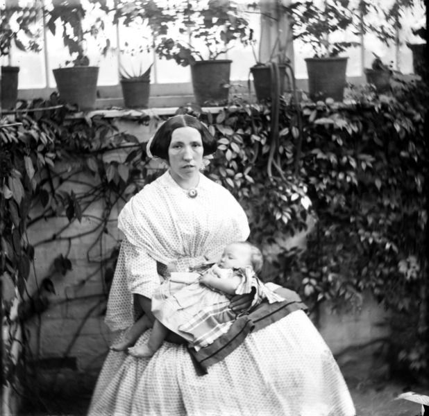 Nurse with a baby at Entally House, Tasmania in 1859. Entally was the residence of Thomas Reiby, grandson of self-made convict girl Mary Reiby. He went on to be Premier of Tasmania. Photograph taken by the first Dean of Sydney University, Professor John Smith