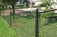 Transform an old ordinary chain link fence with a coat of paint.  Here's what's involved and how much it costs.