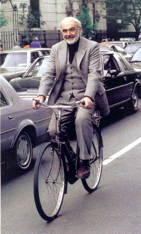 Sean Connery rides a bike.