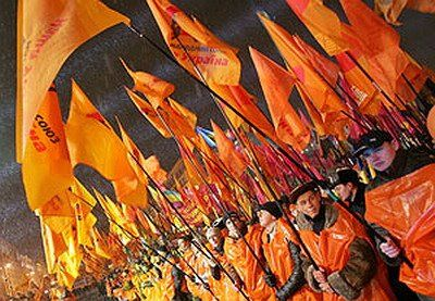 Orange Revolution – Term for the mass protests that followed the rigged presidential run-off elections between Viktor Yanukovych and Viktor Yushchenko in 2004. Though Yanukovych was declared the winner, protests forced the election to be annulled and the run-off was run again, with Yushchenko taking 52% of the vote. The Revolution took its name from the colour worn by Yushchenko's supporters.