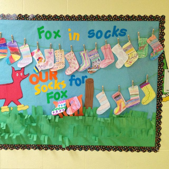 """Your students would get a kick out of writing in sock templates about """"Fox in Sock"""" by Dr. Seuss. I love the idea of creating a laundry line bulletin board display using the students' socks. Great Dr. Seuss bulletin board idea! They used CTP's Dots on Black border."""