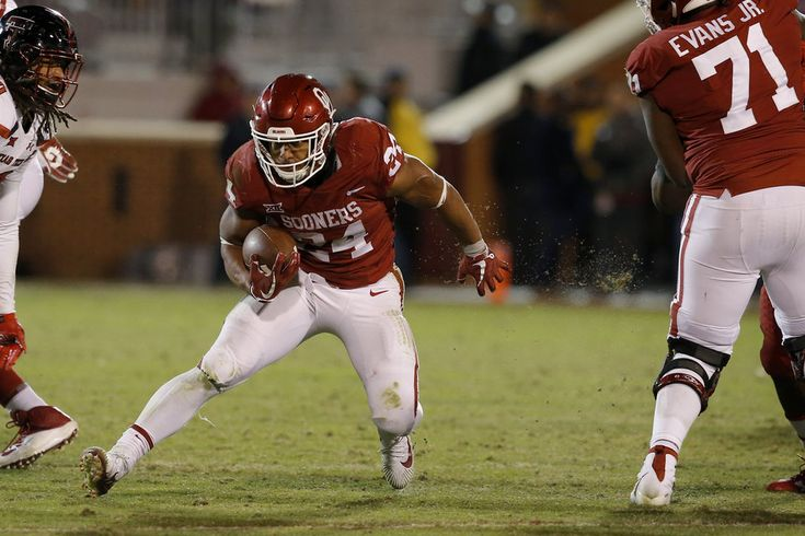 Oklahoma's Rodney Anderson (24) runs the ball during a college football game between the Oklahoma Sooners (OU) and the University of Texas Tech Red Raiders (TTU) at Gaylord Family-Oklahoma Memorial Stadium in Norman, Okla., Saturday, Oct. 28, 2017. Photo by Bryan Terry, The Oklahoman