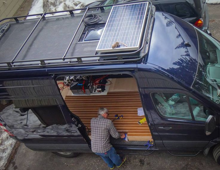 Great view of the Aluminess roof rack with solar panel on top of a Mercedes Sprinter.  Photo cred: Sprinter Van Rat!