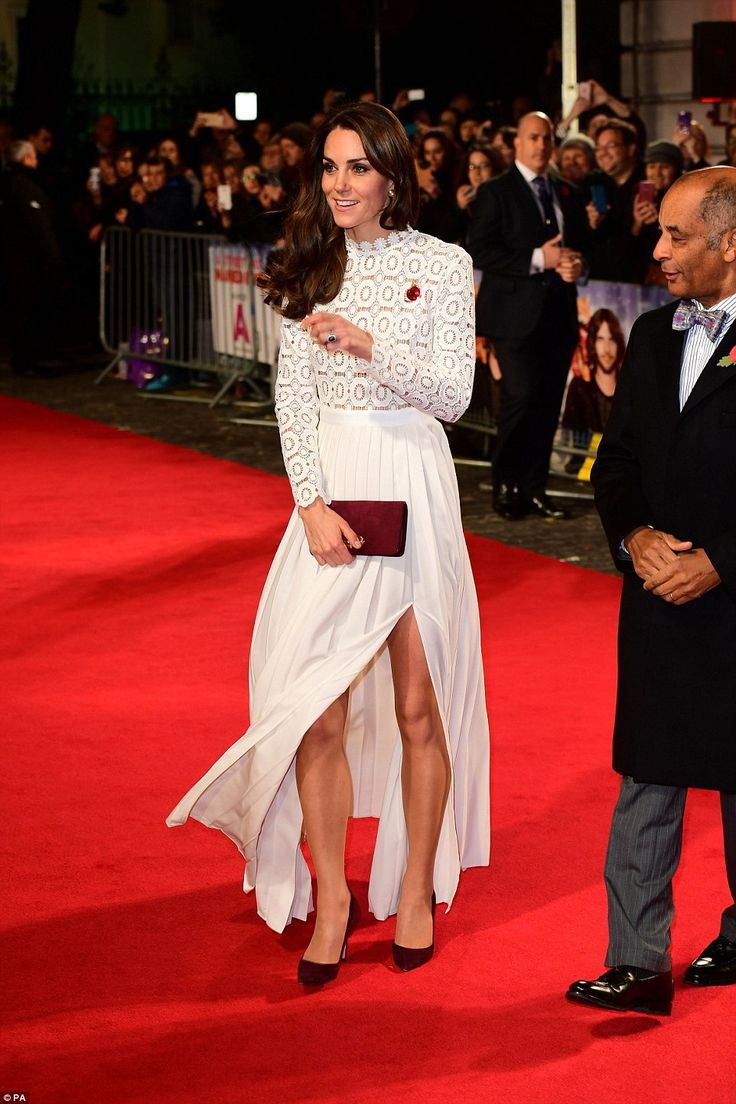 The Duchess, who is never seen without her famous sapphire engagement ring, flashed the rock as she gestured to someone on the red carpet