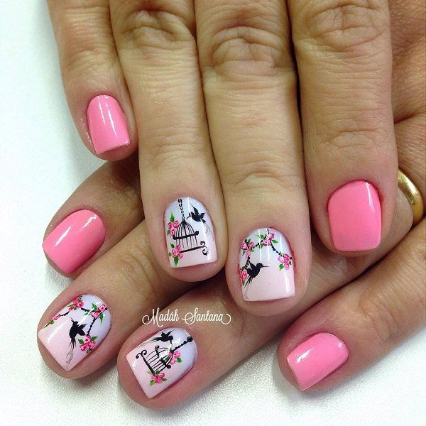 Pink nail art design with birds and birdcages. A wonderful looking pink nail art design using black polish for the bird and cage details. Pink is used as the base color and flower details with green leaves.