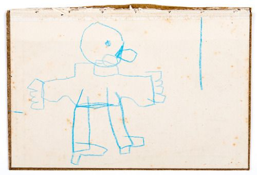 blue man facing the blue line4 9/16″ x 6 5/8″resin stick on book...