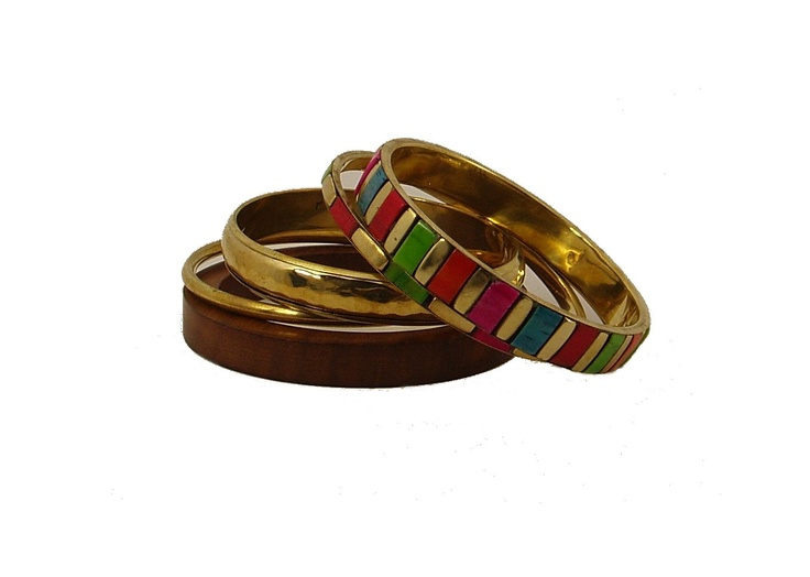 This colorful all hand made set of 5 bangles can all be worn together or just the gold tone pair for a classy look. One of the gold tone bangle is all hand hammered A variety of combinations are possible with this set . Great set for this price.