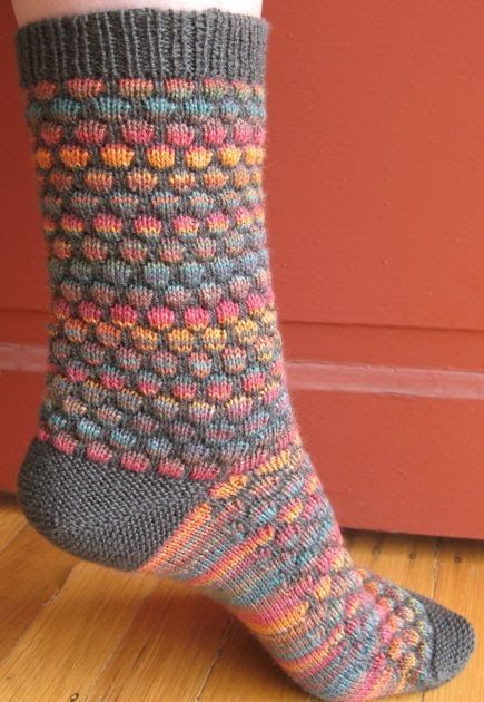 It's finally official. Meet the cousin of the Stained Glass Bubble Hat & Scarf : These colorful socks are worked toe up with short-row gar...
