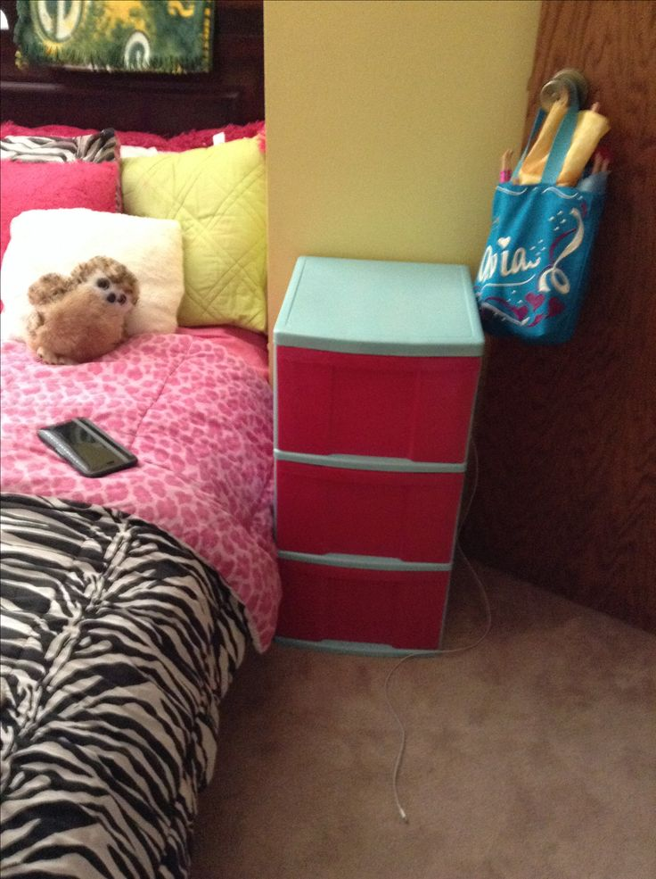 Check this out u spray paint plastic drawers and add handles and it looks like a night stand