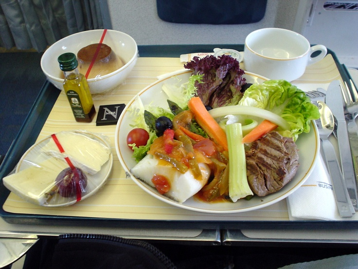 Cod back rioja style and grilled veal tenderloin served on Iberia Airlines business class ...