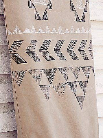 Limited Edition Surfboard Bag from Free People x Chapman at Sea. Khaki canvas, black and white tribal block print