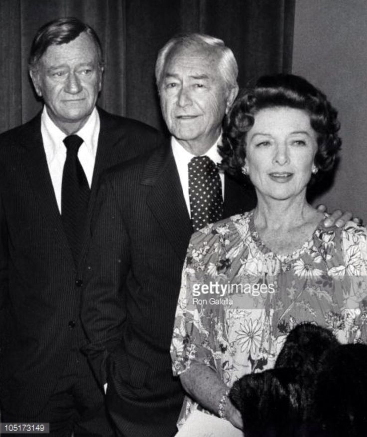 John Wayne, Robert Montgomery and Myrna Loy at a tribute to Joan Crawford at the Sam Goldwyn Theater
