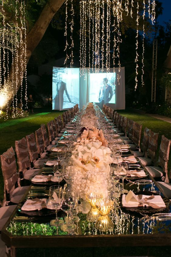 Wedding Outdoor Lights: Big screen slide show at this outdoor event with hanging lights,Lighting