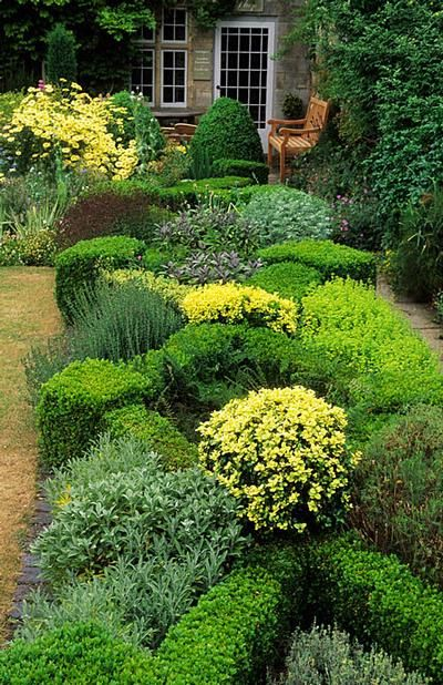 Knot garden with herbs. This is gorgeous. Barnsley House Gloucestershire