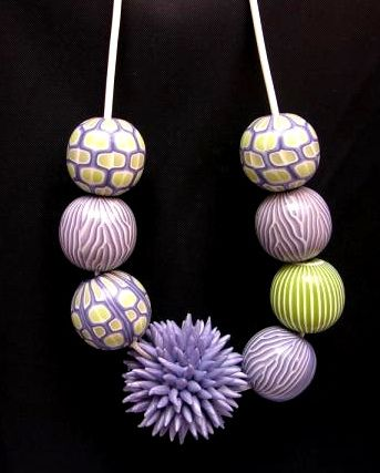 necklace of hollow beads by Tineke Haan (origin from there: http://www.flickr.com/photos/kukel10polymer-clay/5640050085)