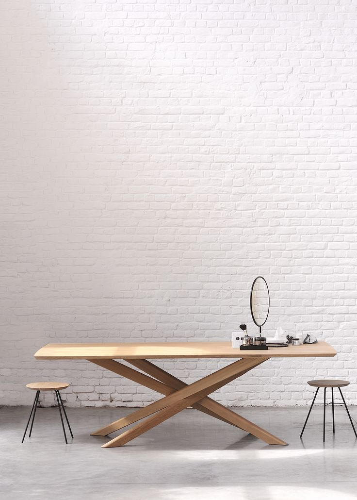Make your dining room a space of inspiration with an architecturally-inspired dining table. The criss-cross design of this solid oak Mikado Table's legs creates an illusion of motion.