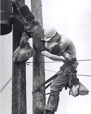 Taken in 1967 by Rocco Morabito, this is one of the most powerful photographs we've seen. Called the Kiss of Life photo, it shows a utility worker named J.D. Thompson giving mouth-to-mouth to co-worker Randall G. Champion after he went unconscious following contact with a high voltage line. What's even more incredible is Champion not only survived this thanks to Thompson, but he lived an extra 35 years. He died in 2002. Thompson is still alive today.