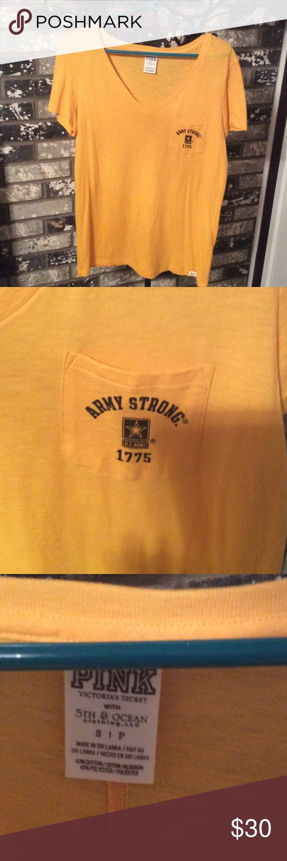 Nwot Pink US Army tee!!✨😳 Army Strong Victoria Secret pink v neck tee. Never worn. Nwot!! Can no longer get this in stores. It's a bright golden yellow. Price is firm unless bundled!! Runs large. Would fit a medium very well and perhaps even a large if you want it tighter. PINK Victoria's Secret Tops Tees - Short Sleeve