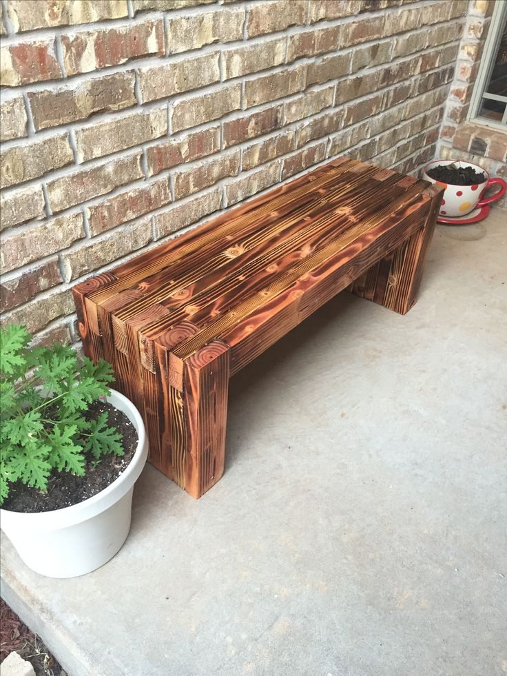Front porch bench i made for my wife it is made from 2 x 4' s that i burnt with a torch and stained with a oil finish