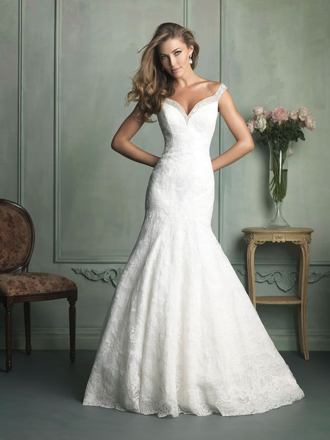 Allure Style 9111 • This romantic collection from Allure Bridals is full of chic shapes and floral detailing