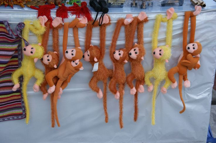 Toy monkeys for sale near the White Emperor Temple, China. October 2011