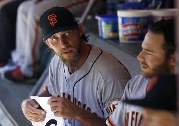 Giants do not foresee surgery for Bumgarner  -  April 22, 2017:    San Francisco Giants' Madison Bumgarner, left, talks with Brandon Crawford, right, in the dugout during the seventh inning of an Opening Day baseball game against the Arizona Diamondbacks Sunday, April 2, 2017, in Phoenix. (AP Photo/Ross D. Franklin) Photo: Ross D. Franklin / Associated Press / Copyright 2017 The Associated Press. All rights reserved.