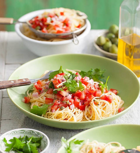 Olive, caper and herb pasta: Look on the light side! This easy-peasy pasta sauce combines fresh tomato and red onion with olives, capers and herbs, plus a little lemon squeezy.