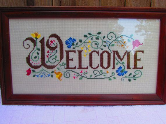 Beautiful, Framed, Cross stitched Welcome sign, sampler. This work is not signed and its a real shame! Ive done a lot of cross stitch and this