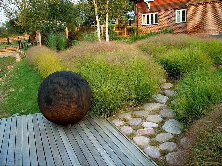Stipa arundinacea hardscaping ornamental grasses for Grasses planting scheme