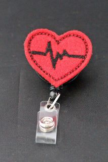 Red Heart Badge for Nurses.  Add some color to your work attire with an ID name badge holder reel!  It is the perfect accessory to your badge at work.  The Heart Rhythm Felt Badge is great for just about anybody in the medical community.