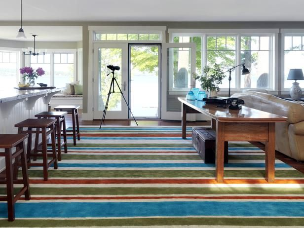 New area rugs can be very expense. Save some money and make a rug. We turned a plain, inexpensive carpet remnant into this gorgeous area rug with upholstery paint and a few rolls of painter's tape.