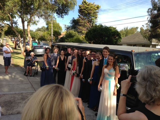 A year 12 Formal group in front of our black hummer limousine.