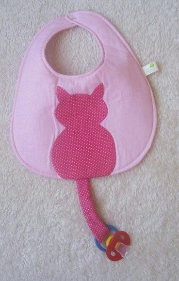 Bib with applique cat where tail is a binky holder