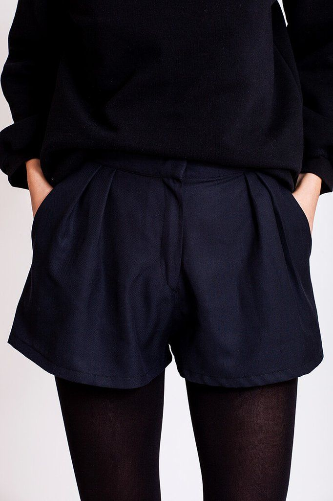 Black shorts by Dott. Are you looking for an item you can mix and match for all sorts of styles? With these high rise cut shorts you'll be able to put together a bunch of different outfits and so you get to wear them more than just for that one date with the cute guy.   €75.00 REPIN TO YOUR OWN INSPIRATION BOARD