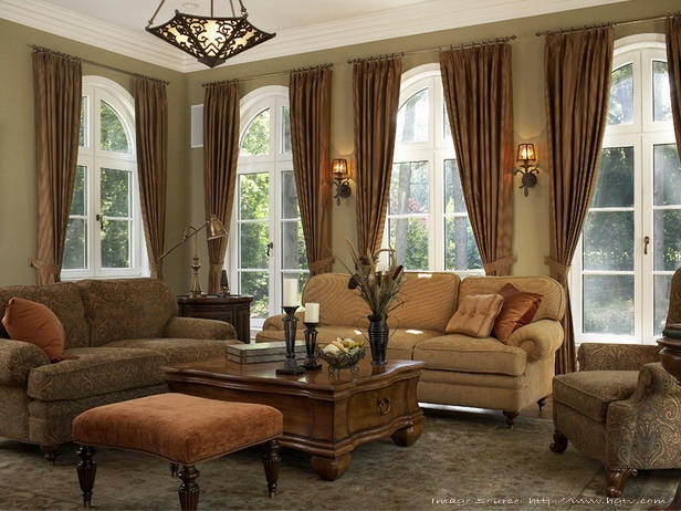 A nice, warm living room for entertaining the crème de la crème! Our living room will never look like this with our little munchkin but I love the style