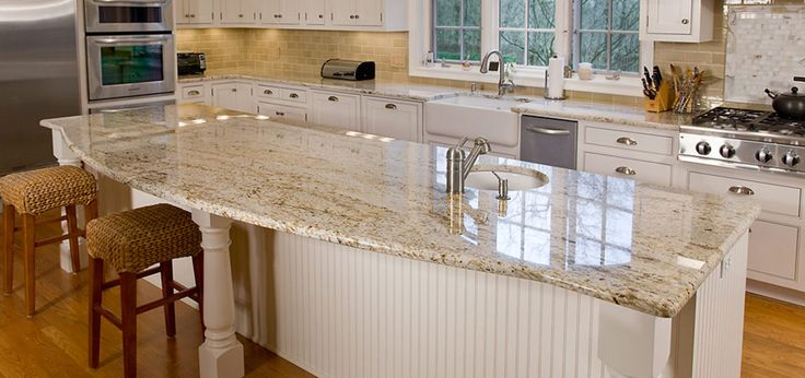 White Kitchen Cabinets Granite Countertop And Tan Walls