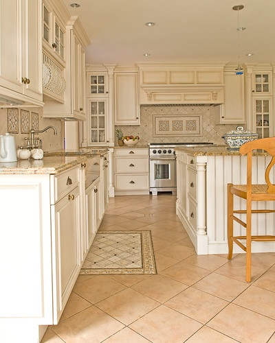 Antique white with brown glaze  Discover tile  The counters are a polished granite: Santa Cecilia Light with Ogee Edge