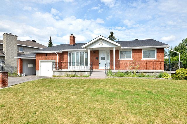 $429,900 or Trade 4 bed backsplit offers completely renovated kitchen & main bath, new roof(2012) and PVC windows(2009). Loads of space with large bedrms & a massive mainflr living rm and LL recrm.This functional layout lends itself well to building an accessory apartment or in law suite with a separate entrance at the back of the house.Attached garage,carport,driveway for 6cars,wrap around veranda,outside brick oven on an incredible 75x100 lot--Must see