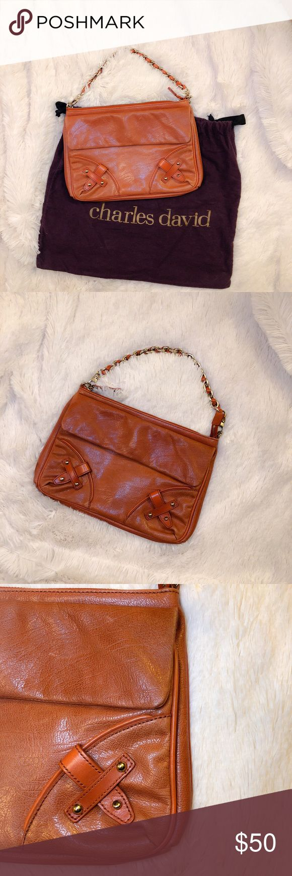 CHARLES DAVID Leather Handbag Charles David leather shoulder in beautiful cognac color. Gold chain strap, front flap pocket and zipper compartment with multiple interior pockets. Pre-loved and in beautiful condition, minor scuffing to the leather throughout from normal use, gives it a distressed look. Original Charles David dust bag included. Reasonable Offers Welcome 🙃 Charles David Bags Shoulder Bags