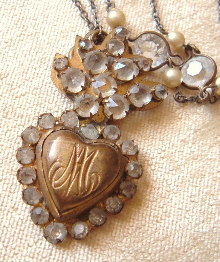 """A rare petite 1800s hand cut paste and brass Ave Maria flaming heart reliquary ex voto suspends from an Art Deco rock crystal and pearl guard chain.    It is beautifully engraved with an """"A and M"""" for Ave Maria, (Hail Mary in Latin) and hinged to open like a locket allowing you to place a message of devotion inside or a photo of a loved one if so desired."""