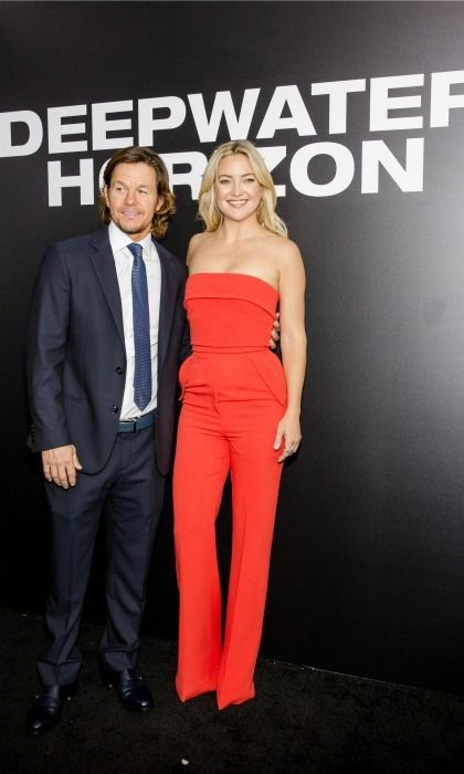 Kate Hudson was red hot in a jumper as she stood next to her co-star Mark Wahlberg during the premiere of their latest film Deepwater Horizon in New Orleans.